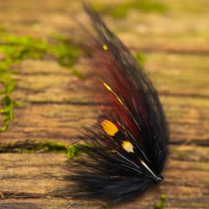 Laxfluga i mönster pahtakorva bunden på tub