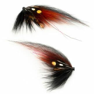 två laxfugor i mönster 'pahtakorva' bundna på tub med hårvinge i färgerna fiery brown och svart