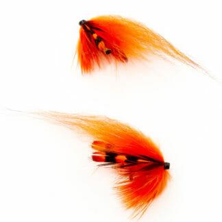 två laxfugor i mönster 'rapala' bundna på tub med hårvinge i färgerna orange