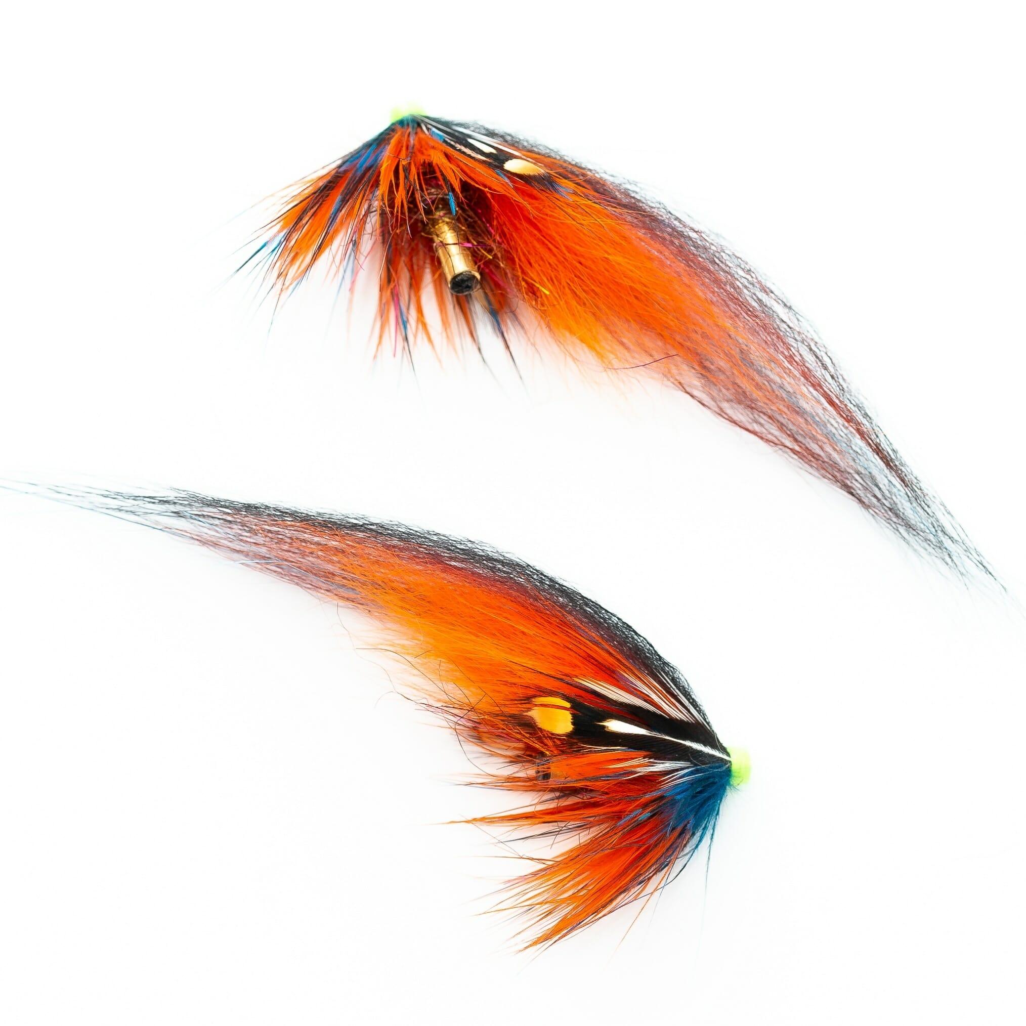 två laxfugor i mönster 'thunder & lightning' på tub med hårvinge i färgerna orange, blå, brunt och svart