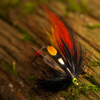 laxfluga i mönster willie gun bunden på tub